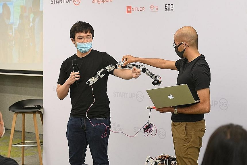 Mr Jeremy Koh (left) pitching his winning idea at Founder Ignite yesterday. He and his partner Aditya Kapoor run Whyte Labs, which teaches children about building robots with mathematics and science knowledge gained from school.