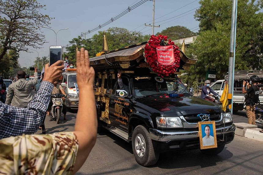 Protesters at the funeral of Mr Thet Naing Win, who was shot last week while taking part in a rally, in Mandalay yesterday. The G-7 nations - comprising Canada, France, Germany, Italy, Japan, Britain and the US - as well as the EU's High Representati