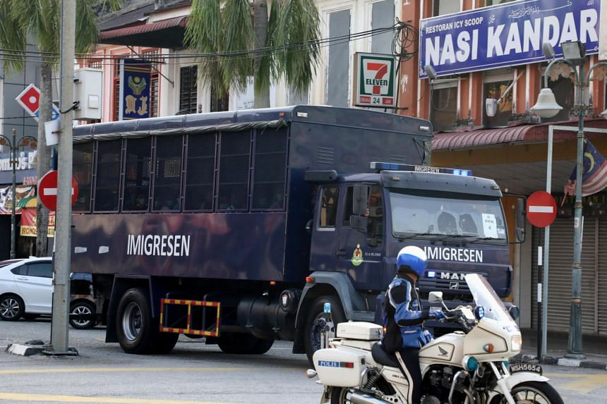 An immigration truck carrying Myanmar migrants to be deported from Malaysia is seen in Lumut, Malaysia, on Feb 23, 2021.