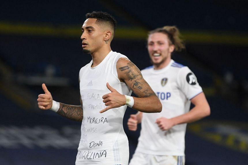 Raphinha Dias Belloli celebrates after scoring Leeds' third goal.