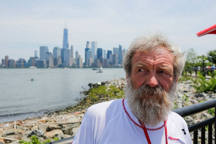 A 2016 photo shows Aleksander Doba in New York, preparing to kayak from the US to Portugal.