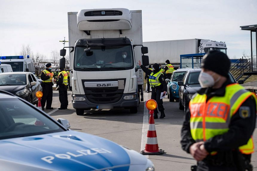 German officers control a truck and several cars at the border with the Czech Republic in Breitenau, as Germany tries to stem the spread of coronavirus variants.
