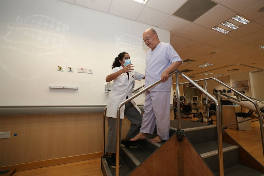 Physiotherapist Vinita Sheri assisting a patient with the use of stairs to improve mobility and muscle strength.