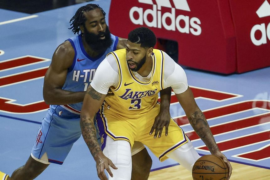 Los Angeles Lakers forward Anthony Davis (3) controls the ball against Houston Rockets guard James Harden.