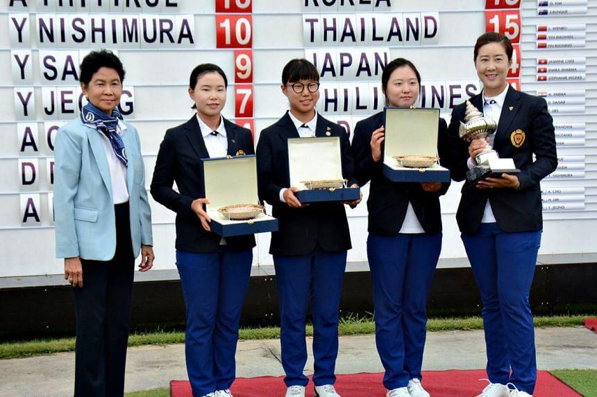 Queen Sirikit Cup Secretary Raevadee T. Suwan poses with the triumphant 2018 Korean team.