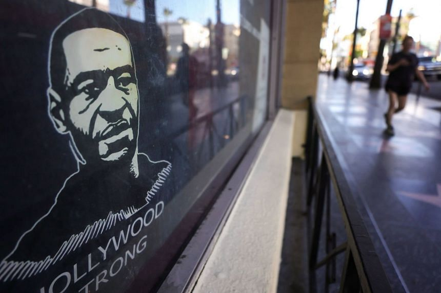 A poster depicting George Floyd is displayed on Hollywood Boulevard in Los Angeles, California.