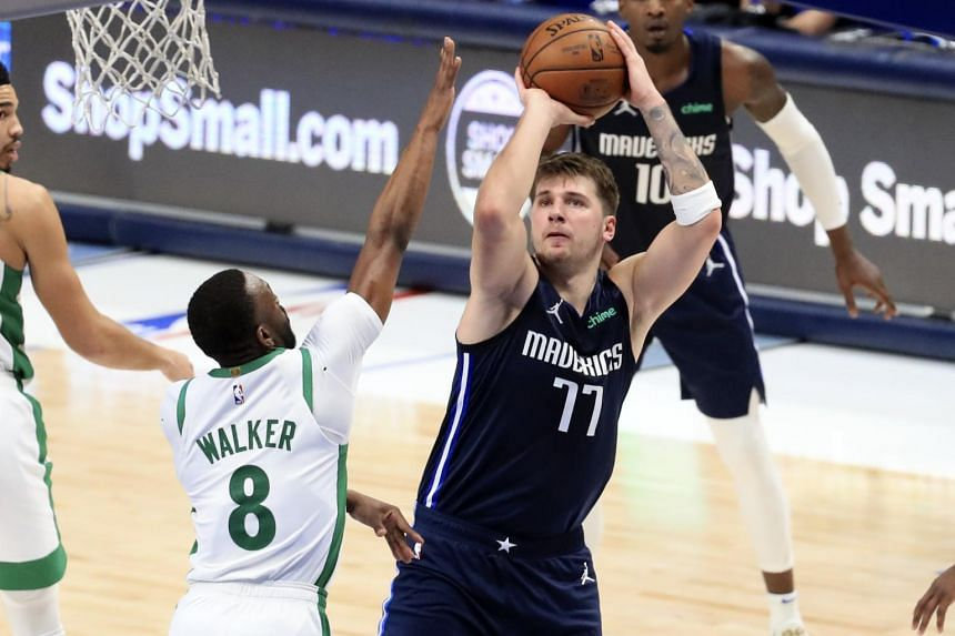 Luka Doncic shoots over Kemba Walker at American Airlines Center, on Feb 23, 2021.