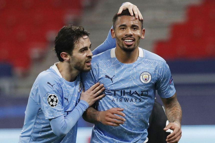 City's Gabriel Jesus celebrates scoring their second goal with Bernardo Silva.