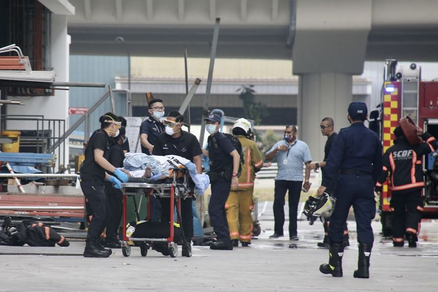 SCDF officers tending to a worker who was injured in an explosion in an industrial building in Tuas on Feb 24, 2021.