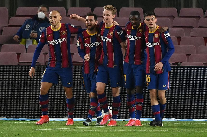 Messi (second left) celebrates with teammates after scoring a second goal against Elche.
