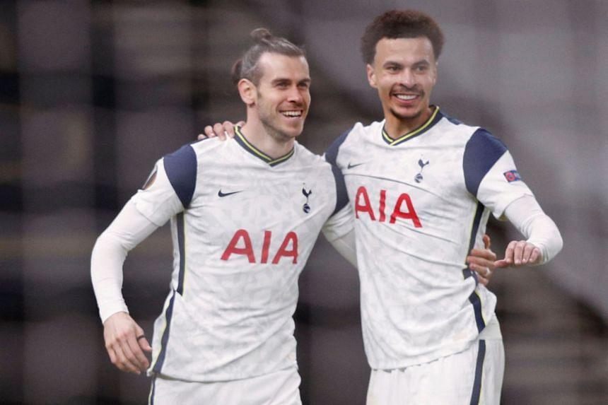 Tottenham's Gareth Bale (left) celebrates scoring his team's third goal with teammate Dele Alli.