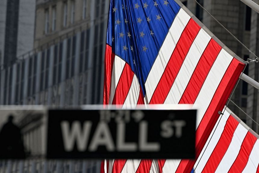 The Dow managed to shrug off early weakness to finish at a new record.