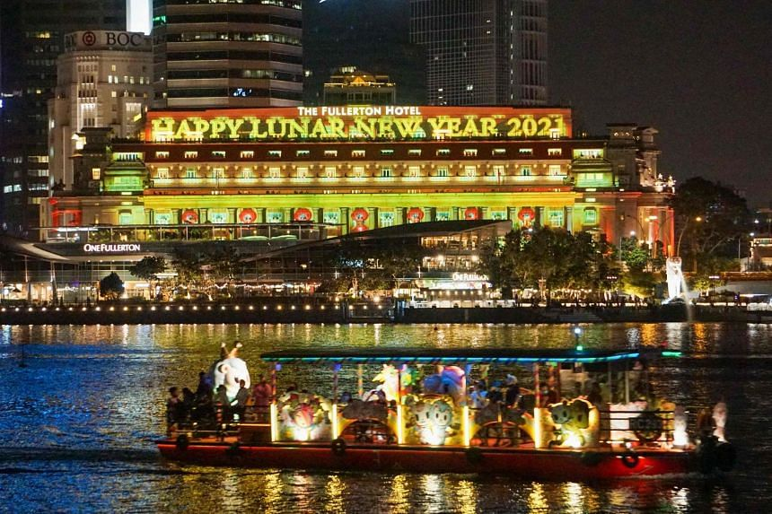 This photograph taken February 13, 2021 shows the Fullerton Hotel in Singapore decorated with lights celebrating the Lunar New Year, which ushered in the Year of the Ox on February 12.