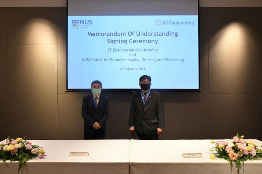 Crisp director Kwoh Leong Keong (left) and ST Engineering Geo-Insights general manager Goh Ing Nam at the signing of the MOU.