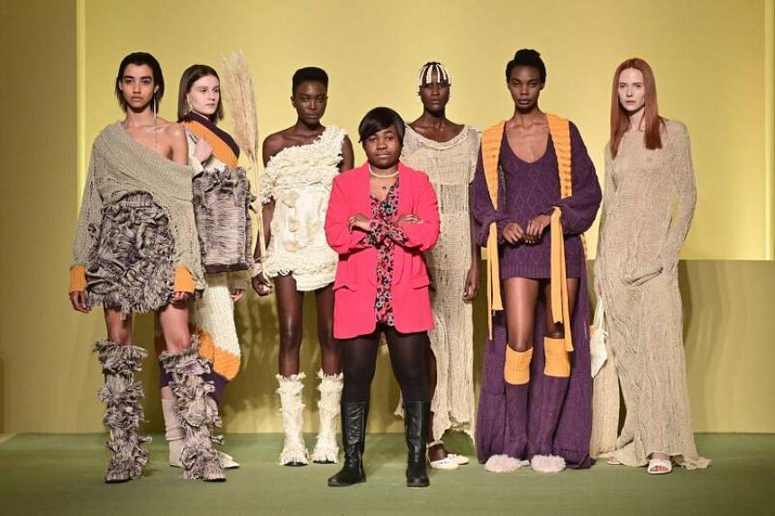 Cameroonian fashion stylist Claudia Gisele Ntsama (centre) poses with her models, on Feb 17, 2021.