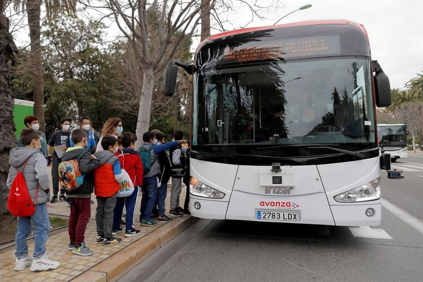 Children wait to board the bus in Malaga, Feb 24, 2021.