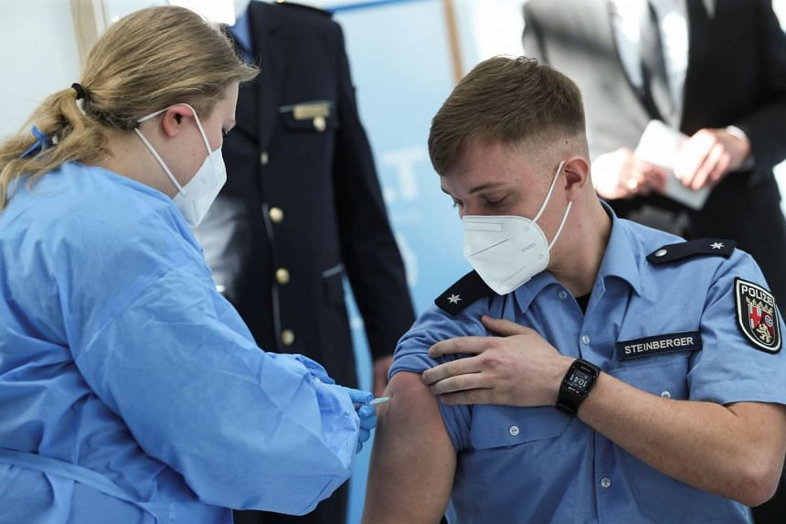 A German police staff member receives a dose of AstraZeneca's vaccine in Mainz, Germany, Feb 25, 2021.
