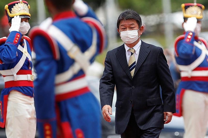 """Japan's Foreign Minister Toshimitsu Motegi arriving for a meeting with his Brazilian counterpart in Brasilia last month. Mr Motegi said yesterday: """"It will be dangerous if someone takes advantage of the Covid-19 crisis to justify the already existing"""