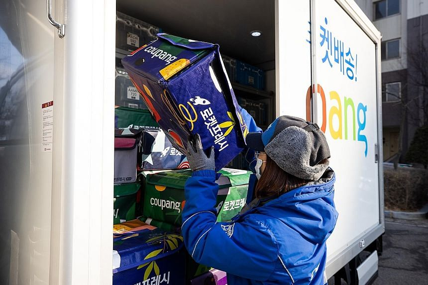 A Coupang employee unloading fresh food from a truck in Bucheon, South Korea. Founded in 2010, Coupang is a major e-commerce and on-demand food delivery player in the country. A listing on the New York Stock Exchange could spell gains for SPH and the