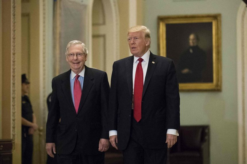 Mr Donald Trump and Senate Minority Leader Mitch McConnell on Capitol Hill in Washington DC on Oct 24, 2017.