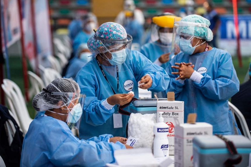 A nurse prepares a dose of the Sinopharm vaccine during a health workers vaccination campaign in Lima, on Feb 19, 2021.