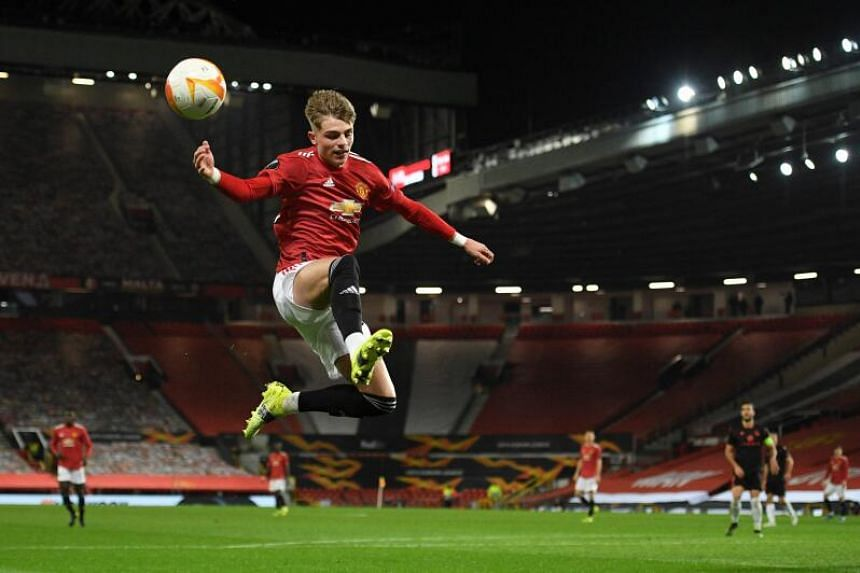 Manchester United's English defender Brandon Williams leaps for the ball in Manchester, on Feb 25, 2021.
