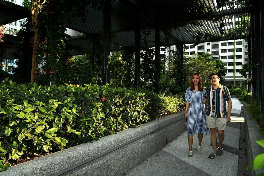 Bidadari residents Jeffrey Chong and Heather Yew strolling along the Garden Terrace in the estate.