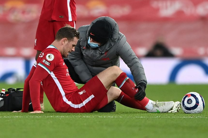 Liverpool's Jordan Henderson receiving medical attention during the match against Everton, on Feb 20, 2021.