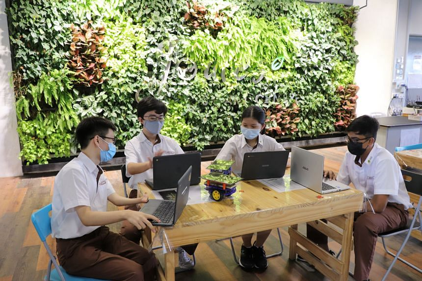 Bukit View Secondary School students using their personal learning devices. Education Minister Lawrence Wong says the security software built into learning devices does not track details such as passwords and locations. PHOTO: COURTESY OF BUKIT VIEW
