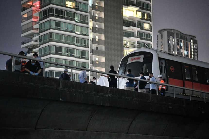 Police and SCDF personnel with the stationary MRT train on the east-bound track near Kallang station, on Feb 25, 2021. SMRT said the incident took place at about 9.30pm.
