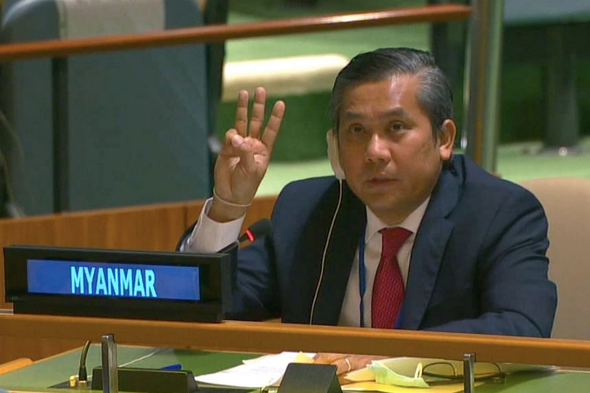 Myanmar's ambassador to the United Nations Kyaw Moe Tun holds up three fingers at the end of his speech to the General Assembly in New York, on Feb 26, 2021.