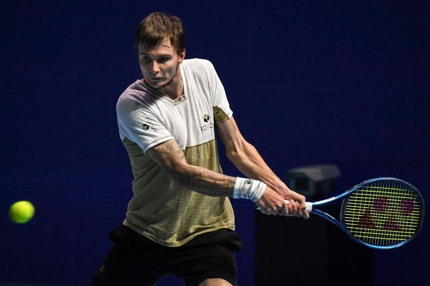 Kazakhstan's Alexander Bublik hits a return against Moldova's Radu Albot at the Singapore Tennis Open tournament in the OCBC Arena, on Feb 27, 2021.