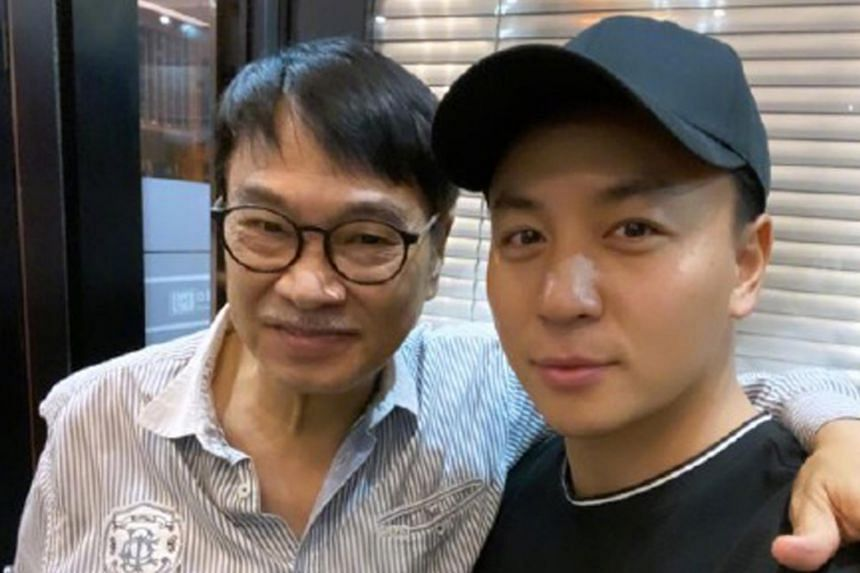 Mr Ng Man Tat with Chinese actor Shi Xiaolong in a photo posted by Shi in October 2020.