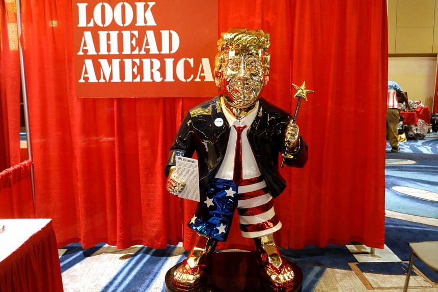 The statue of the former president, dressed in a jacket, red tie and Stars-and-Stripes boxing shorts, was on display at the conference site.