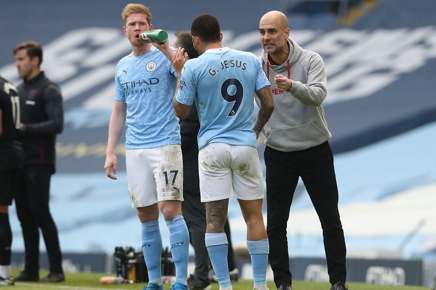 Manchester City manager Pep Guardiola (right) talks to Gabriel Jesus (centre) during their match against West Ham United in Manchester, on Feb 27, 2021.
