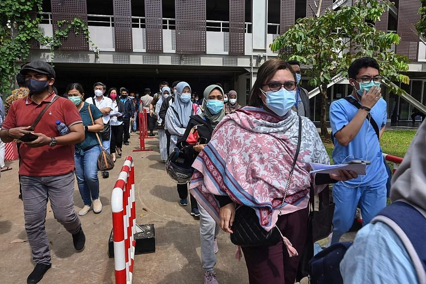 Health workers queueing for the vaccine at a sports stadium in Jakarta earlier this month. Controversy has dogged the vaccination drive, with long queues and limited supplies of the vaccine.