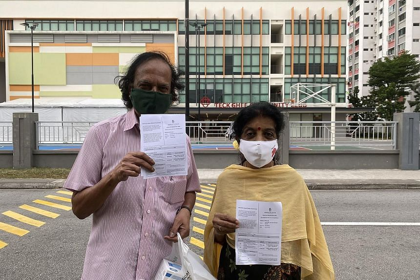 Above: Arts instructor Jarosani Thevi, 72, and husband Arunachala Thevar Baskaran, 75, had their two shots this month. Ms Jarosani said neither of them had any side effects. Left: Ang Beng Giap, 73, said that the process of getting his second jab on