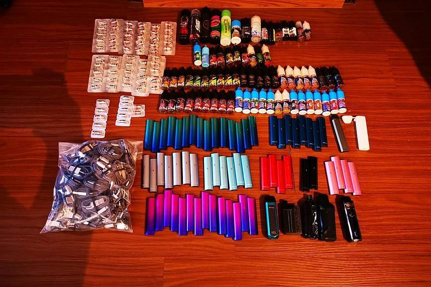(Left): HSA's operation last July seized 5,368 vaping products with a street value of about $53,680. (Above): ICA officers at Woodlands Checkpoint detected over 2,000 e-vaporiser products hidden in a car on Jan 23 last year. HSA was alerted and this