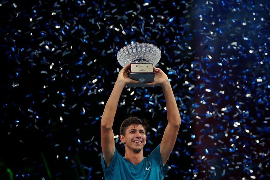 Alexei Popyrin celebrating after winning the Singapore Tennis Open, on Feb 28, 2021.