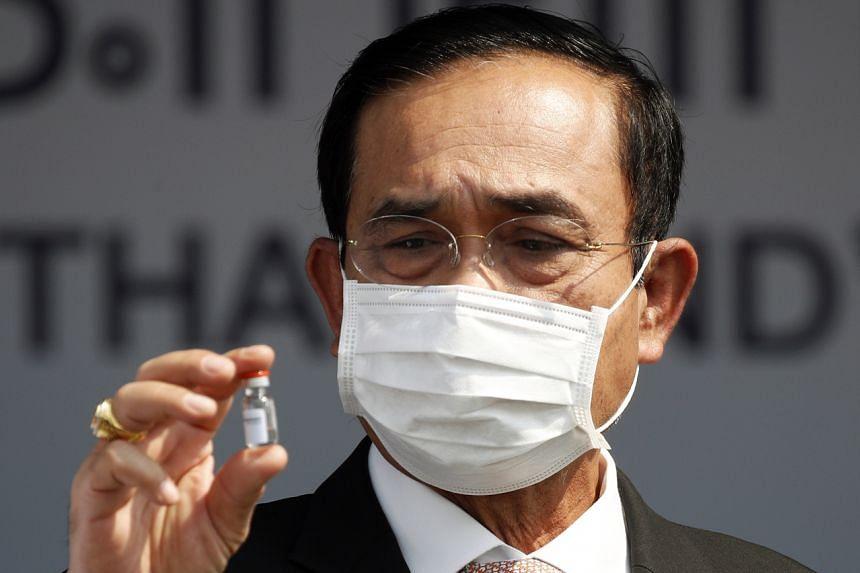 Thai Prime Minister Prayut Chan-o-cha holding a sample of the Sinovac vaccine on Feb 24, 2021.