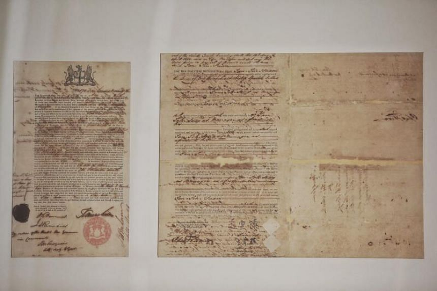 The Thian Hock Keng temple's original land sales record. One dated 1828 (left), shows how the land on which the Thian Hock Keng Temple sits was originally owned by the British East India Company. The other, dated 1838, bears the original signature of
