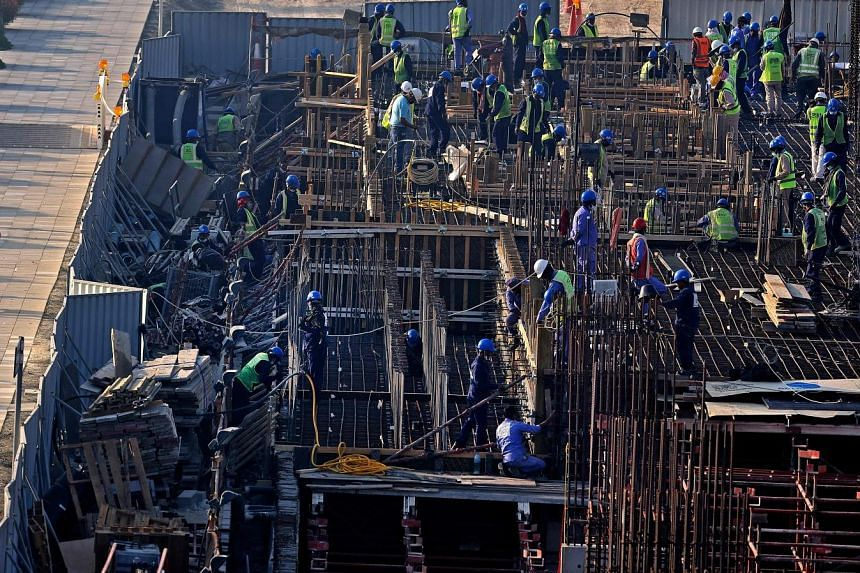 Construction workers at a building site in Dubai Creek last month. Remittances to the Philippines fell 0.8 per cent last year. Officials expect remittances to grow 4 per cent this year but a Manila-based recruitment consultant believed the rate would