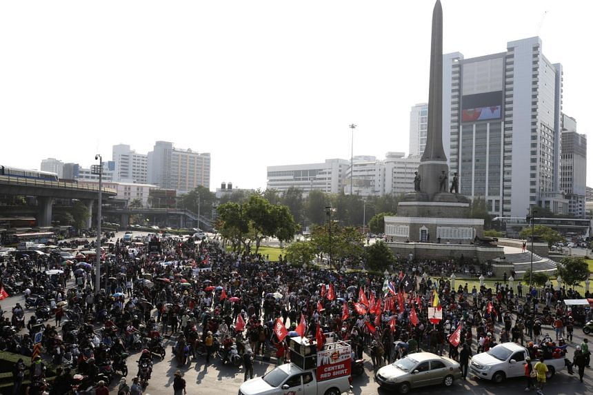 Anti-government protesters gather at Victory Monument during a protest in Bangkok, on Feb 28, 2021.
