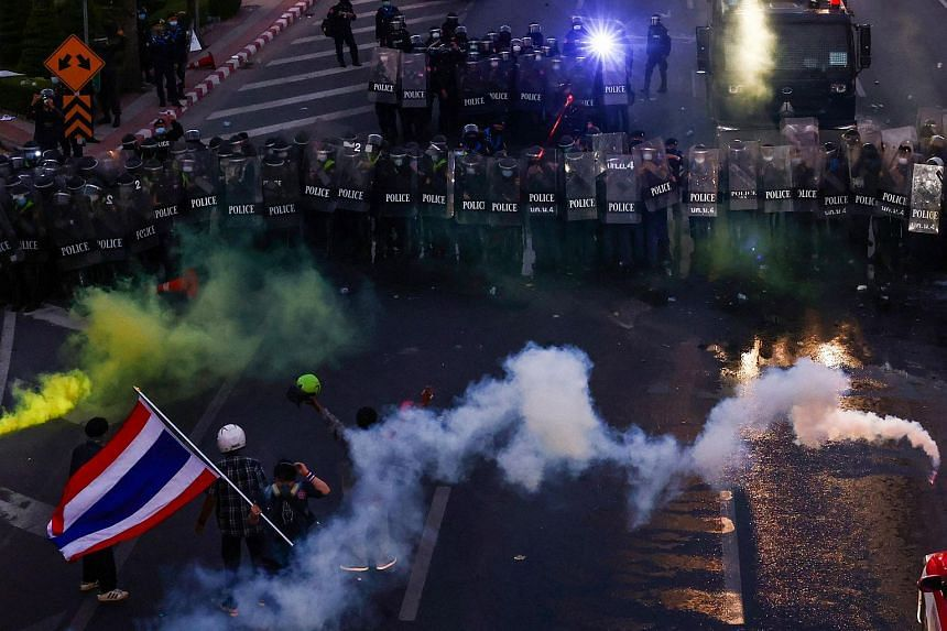 Thai riot police officers using tear gas to try to disperse protesters during a demonstration in Bangkok, on Feb 28, 2021.