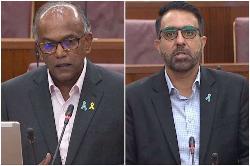Home Affairs Minister K. Shanmugam (left) and Leader of the Opposition Pritam Singh in Parliament on March 1, 2021.