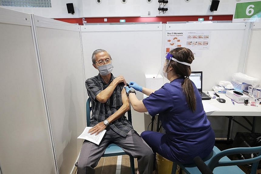 The Covid-19 vaccine being administered at the vaccination centre in Jalan Besar Community Club last month. Besides Covid-19 test results, Singapore will look into extending HealthCerts to capture vaccination records. Medical technologists at Innovat