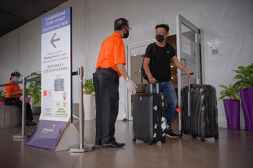 A traveller at the Covid-19 polymerase chain reaction test facility at Changi Airport Terminal 3 last month. Singapore will continue to use tests and stay-home notice requirements to ensure that travellers do not bring the virus into the community, s