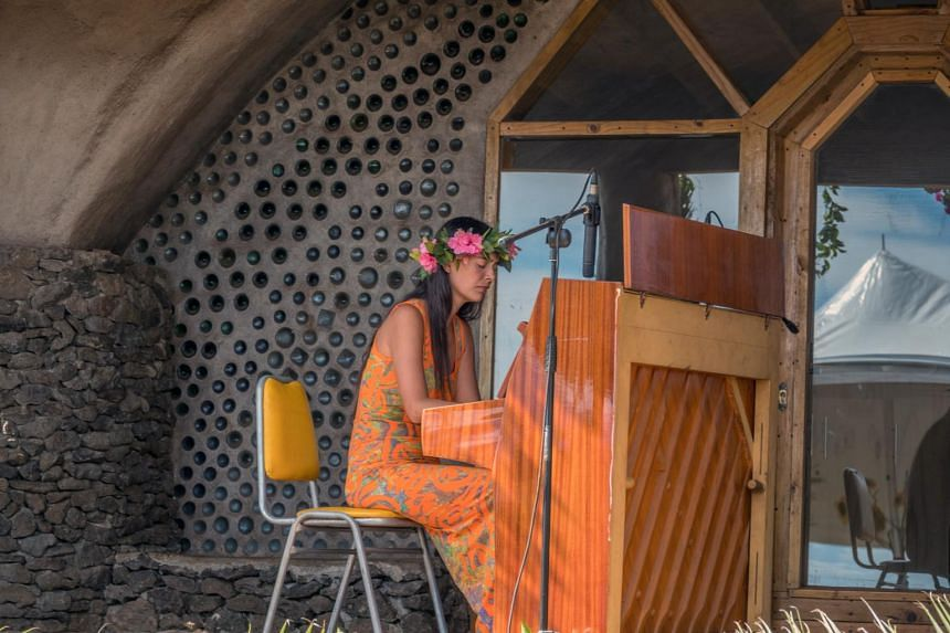 Mahani Teave playing a piano on Rapa Nui, also known as Easter Island, in 2018.