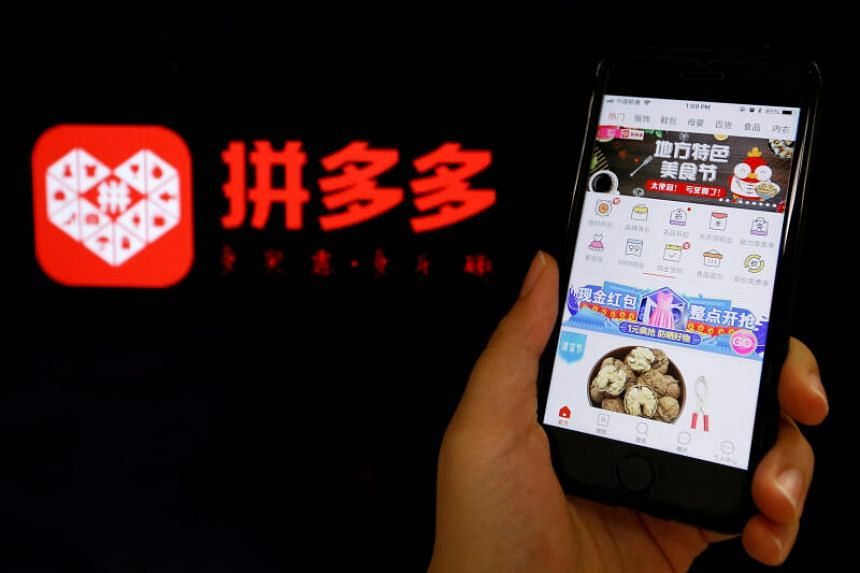The logo of Chinese online group discounter Pinduoduo is seen next to its mobile phone app in this illustration picture taken July 17, 2018.