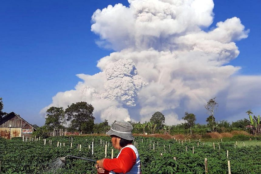 Mount Sinabung spews ash into the sky, as seen from Karo, North Sumatra on March 2, 2021.